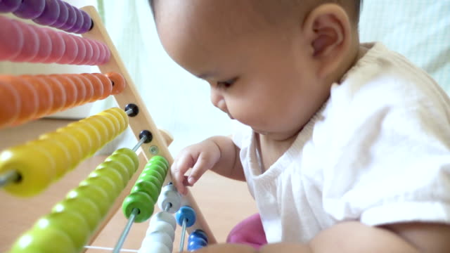 baby playing colorful abacus toy - babies in a row stock videos & royalty-free footage
