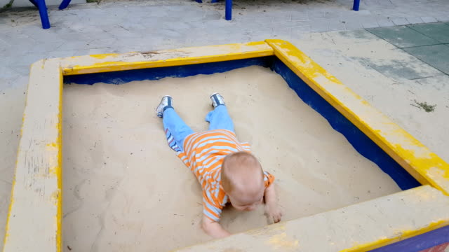 baby playing in sandbox - sand pit stock videos and b-roll footage
