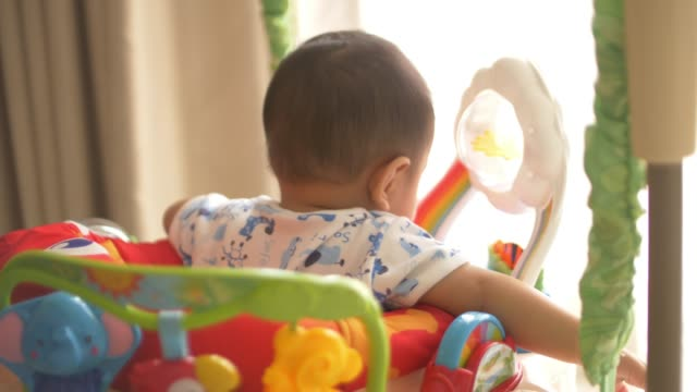 77b730627 Baby Playing Jumper Toy Stock Footage Video