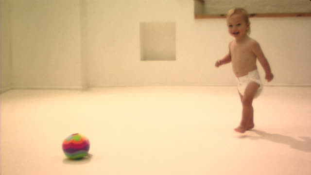 baby playing with ball - part of a series stock videos & royalty-free footage