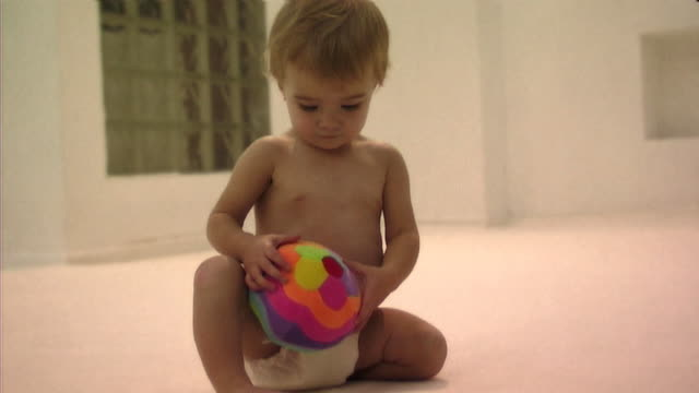 Baby playing with ball