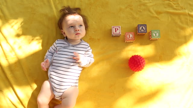 a baby playing with balls and toys inside of her home. - block shape stock videos & royalty-free footage