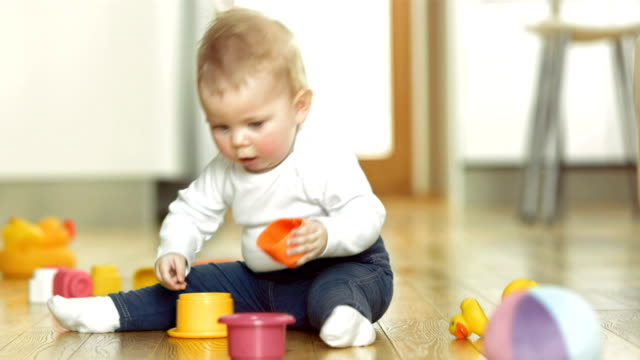 Baby Playing With Blocks On The Floor