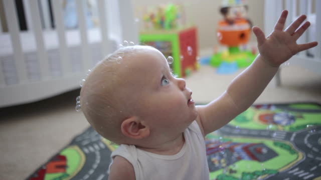 Baby Playing with Bubbles