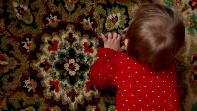 baby playing with carpet - part of a series stock videos & royalty-free footage