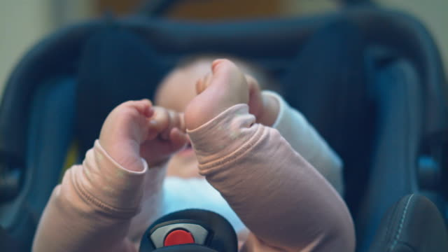 baby playing with her arms and feet - 6 11 mesi video stock e b–roll