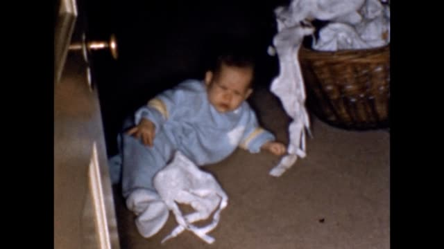 1958 baby playing with laundry - laundry basket stock videos and b-roll footage