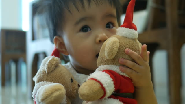 baby playing with santa bear - baby boys stock videos & royalty-free footage