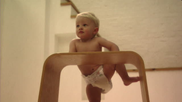 baby playing with stool - one baby boy only stock videos & royalty-free footage