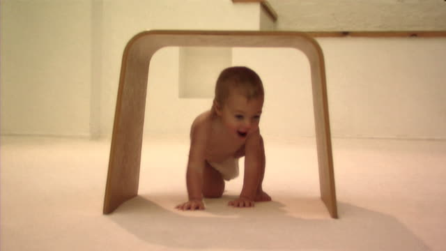Baby playing with stool