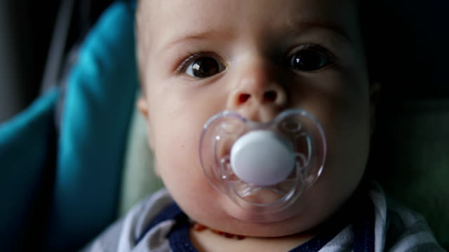 baby playing with toy, close up - pacifier stock videos and b-roll footage