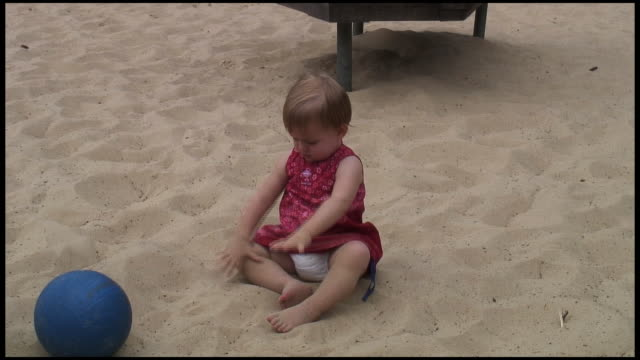 (hd1080) baby plays with sand - one baby girl only stock videos & royalty-free footage