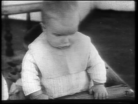 stockvideo's en b-roll-footage met b/w 1921 baby pointing then looking angry during famine / russia / newsreel / slate at end of shot - 1921