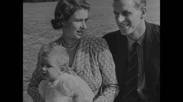 cu baby prince charles sitting on blanket looking at camera / charles sits in mother princess elizabeth's lap father prince philip sitting next to... - prince philip stock videos & royalty-free footage