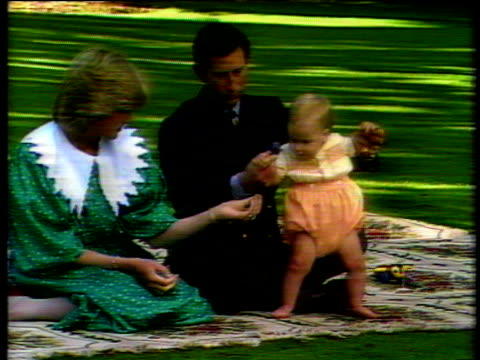 Baby Prince William sits in lap of Prince Charles and Princess Diana before press for photocall New Zealand 23 Apr 83