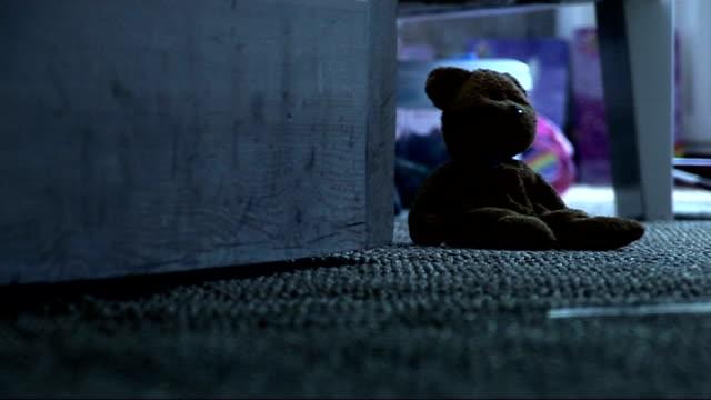 vídeos y material grabado en eventos de stock de baby p's stepfather found guilty of raping 2 year old girl; int close shots of teddy bear on floor, rag doll and child's rocker - trapo de limpiar el polvo