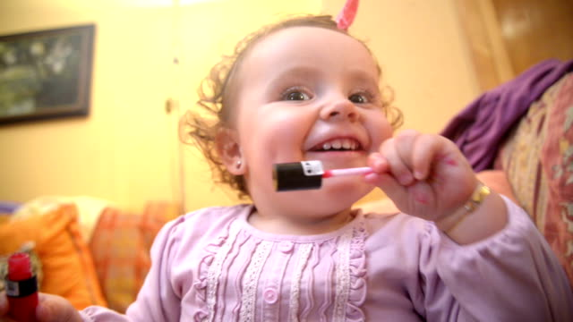 baby putting on make up - human tongue stock videos & royalty-free footage
