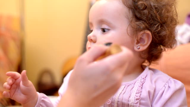 baby putting on make up - blusher make up stock videos and b-roll footage