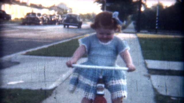 stockvideo's en b-roll-footage met baby red trycicle 1949 - 1940 1949