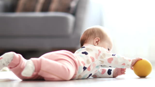 baby rolling rolling around on the floor - babies only stock videos & royalty-free footage