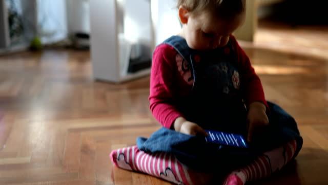 baby ruining smart phone - destruction stock videos & royalty-free footage