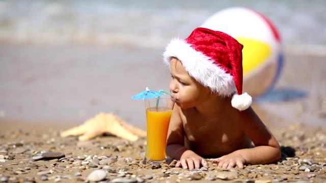 Baby Santa Claus on the beach