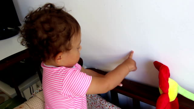 baby scratching the wall in the bedroom - babies in a row stock videos & royalty-free footage