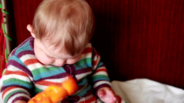 baby shaking toy - rhythm stock videos and b-roll footage