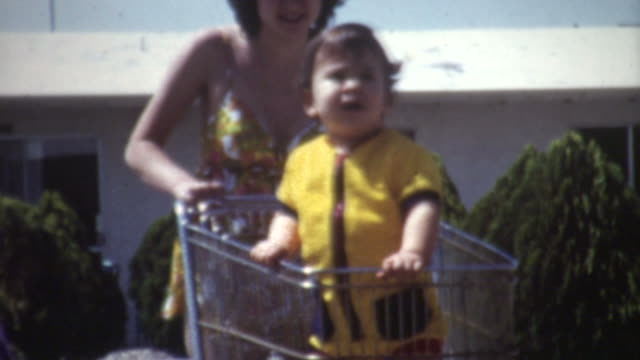 baby shopping cart 1972 - shopping trolley stock videos & royalty-free footage