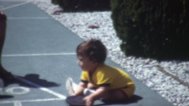 baby shuffleboard 1960's - grandchild stock videos & royalty-free footage