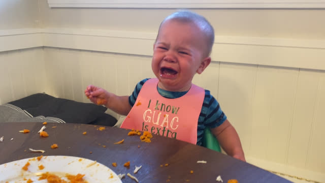 baby sitting at table starts to cry (audio) - waist up stock videos & royalty-free footage