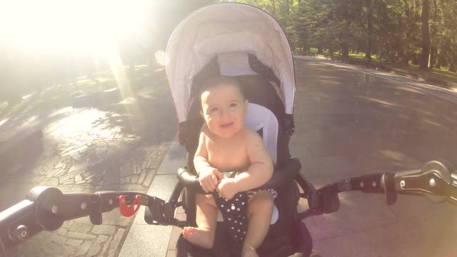 baby sitting in a carriage - pushchair stock videos and b-roll footage