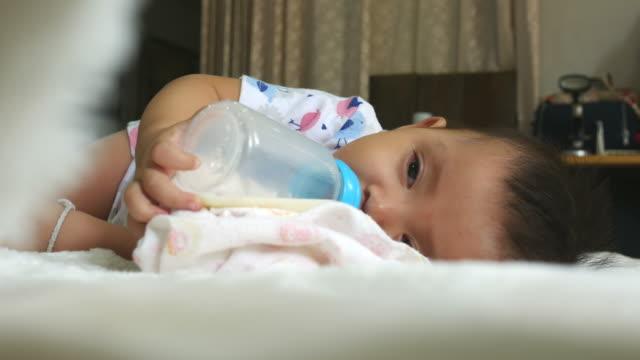 baby sleep while drinking milk bottle - milk bottle stock videos & royalty-free footage