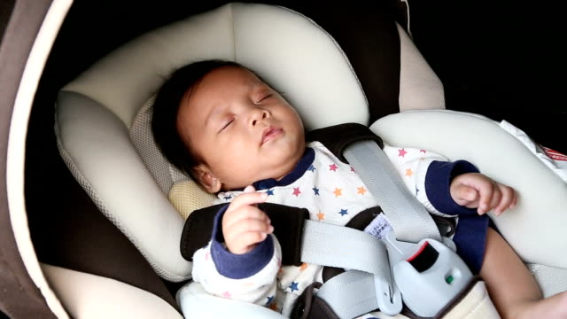 Baby sleeping in car seat.