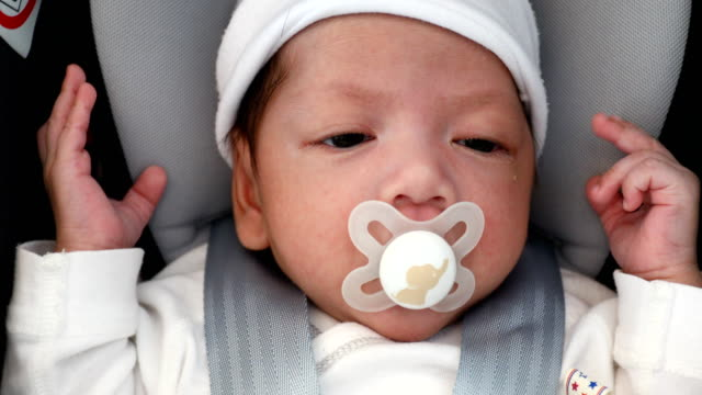 baby sleeping in car seat - pacifier stock videos and b-roll footage