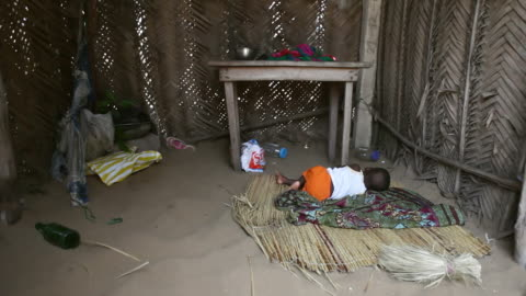 ms baby sleeping in hut at fisherman village / togo - one baby boy only stock videos & royalty-free footage