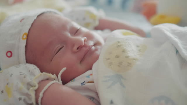 a baby sleeping indoors on bed - 0 1 months stock videos & royalty-free footage
