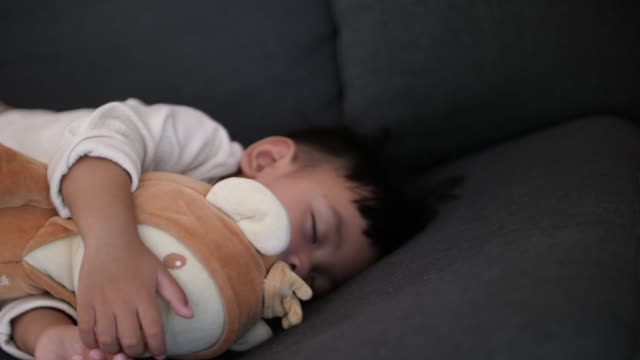 baby sleeping with teddy bear - teddy bear stock videos and b-roll footage