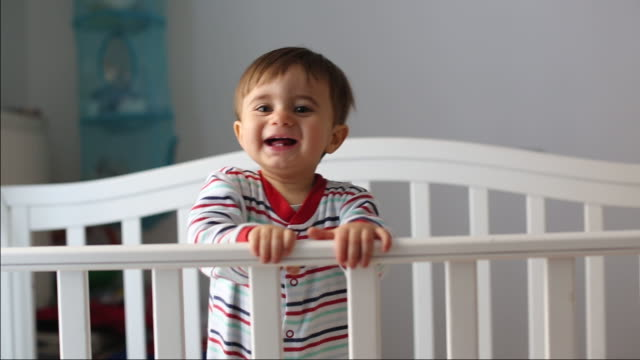 stockvideo's en b-roll-footage met baby smiling - one baby boy only