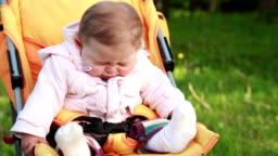 Baby sneezing in the park
