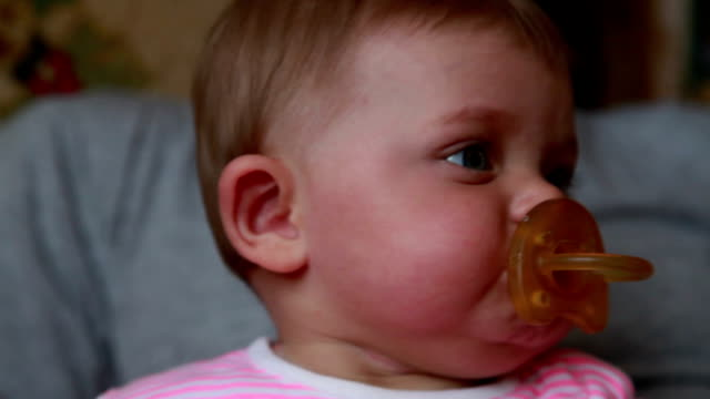 baby spits out pacifier - pacifier stock videos and b-roll footage