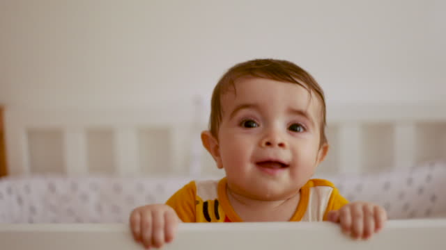 baby standing in cradle and smiling - babies only stock videos & royalty-free footage