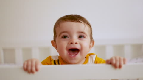 baby standing in cradle and smiling - argentinian ethnicity stock videos & royalty-free footage