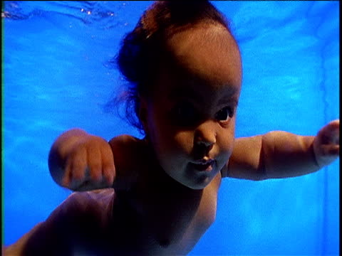 baby swimming underwater blue background - babyhood stock videos & royalty-free footage