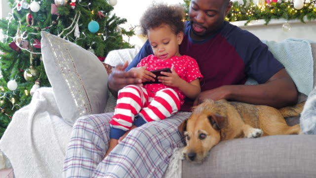 baby taking over mobile on christmas - christmas morning stock videos & royalty-free footage