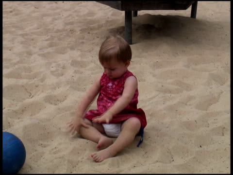 baby / toddler plays with sand - babyhood stock videos & royalty-free footage