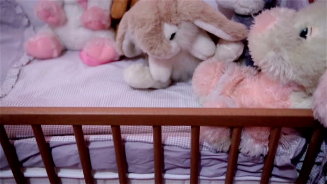 baby toys - cot stock videos & royalty-free footage