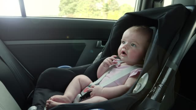 4k: baby travelling in back in car seat - back seat stock videos and b-roll footage
