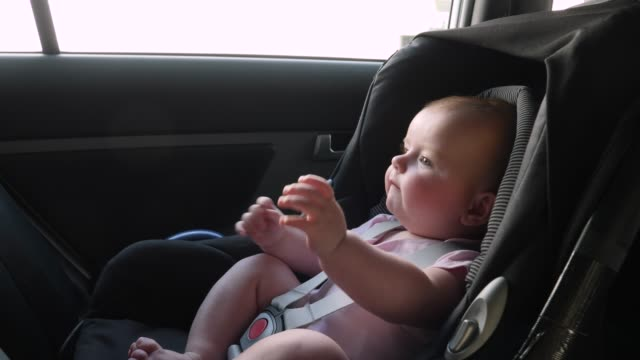 4k: baby travelling on journey in car seat - back seat stock videos and b-roll footage