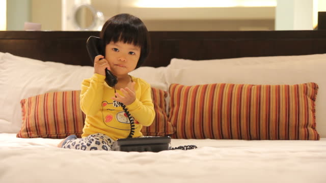 HD : Baby using a telephone
